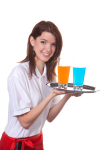 young woman as a waitress serves drinks on a tray